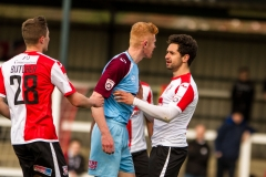 April 9 2016 - Kingfield Stadium - Woking - England - Tempers flare btween Gateshead defender James Curtis and Woking Striker Giuseppe Sole (10) during the National League match between Woking & Gateshead.