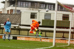 April 9 2016 - Kingfield Stadium - Woking - England - Gateshead goalkeeper Sam Russell is unable to keep out the opening goal during the National League match between Woking & Gateshead.