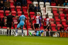 April 9 2016 - Kingfield Stadium - Woking - England - Referee Robert Whitton points to the spot after Gateshead defender James Curtis is pulled down by Woking Defender Brian Saah (5) during the National League match between Woking & Gateshead.