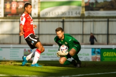 April 22 2016 - Kingfield Stadium - Woking - England - Eastleigh Goalkeeper Ross Flitney (1) saves at the feet of Woking Midfielder Keiran Murtagh (8) during the National League match between Woking & Eastleigh.