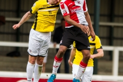 April 30 2016 - Kingfield Stadium - Woking - England - Woking Midfielder Keiran Murtagh (8) and Eastleigh Defender Paul Reid (6) jump for the ball during the National League match between Woking & Eastleigh.