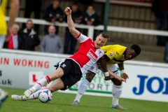 April 30 2016 - Kingfield Stadium - Woking - England - Eastleigh Striker Yemi Odubade (7) pulls down Woking Defender Mark Ricketts (4) during the National League match between Woking & Eastleigh.