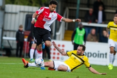 April 30 2016 - Kingfield Stadium - Woking - England -Woking Midfielder Bruno Andrade (15) gets away from the tackle of Eastleigh Midfielder Josh Payne (8) during the National League match between Woking & Eastleigh.