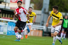 April 30 2016 - Kingfield Stadium - Woking - England - Woking Midfielder Bruno Andrade (15) out runs Eastleigh Defender Michael Green (3) during the National League match between Woking & Eastleigh.