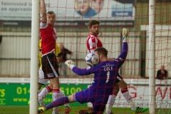 April 22 2016 - Kingfield Stadium - Woking - England - Woking Goalkeeper Jake Cole (1) is beaten by Eastleigh Striker Ross Lafayette (11) early in the first half of the National League match between Woking & Eastleigh but the goal is ruled out for off side.