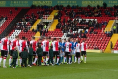 March 5 2016 - Kingfield Stadium - Woking - England - Teams shake hands during the National League match between Woking & Dover Athletic.