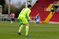 March 5 2016 - Kingfield Stadium - Woking - England - Dover Goalkeeper Mitchell Walker (1) gets an early feel of the ball during the National League match between Woking & Dover Athletic.