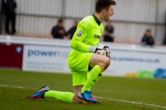 March 5 2016 - Kingfield Stadium - Woking - England - Dover Goalkeeper Mitchell Walker (1) gathers a shot during the National League match between Woking & Dover Athletic.