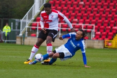 March 5 2016 - Kingfield Stadium - Woking - England - Woking Defender Chris Arthur (3) fouls Dover Winger Ricky Modeste (7) during the National League match between Woking & Dover Athletic.