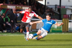 March 5 2016 - Kingfield Stadium - Woking - England - Dover Midfielder Liam Bellamy (8) tackles Woking Midfielder Carr (23) during the National League match between Woking & Dover Athletic.