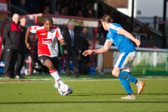 March 5 2016 - Kingfield Stadium - Woking - England - Woking's Carr takes on Dover Midfielder Liam Bellamy (8) during the National League match between Woking & Dover Athletic.