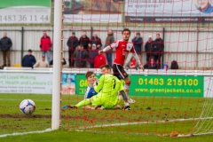 March 5 2016 - Kingfield Stadium - Woking - England - Woking Midfielder John Goddard (11) beats Dover Goalkeeper Mitchell Walker (1) but sees his shot go agonisingly wide during the National League match between Woking & Dover Athletic.