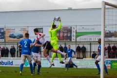March 5 2016 - Kingfield Stadium - Woking - England - Dover Goalkeeper Mitchell Walker (1) beats Woking Striker Giuseppe Sole (10) to a cross during the National League match between Woking & Dover Athletic.