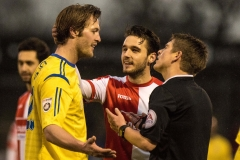 February 13 2016 - Kingfield Stadium - Woking - England - Referee Richard Martin cools things down between Woking Midfielder John Goddard (11) and Guiseley Defender Rob Atkinson (25) during the National League match between Woking & Guiseley.