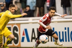 February 13 2016 - Kingfield Stadium - Woking - England - Woking Midfielder John Goddard (11) races for the ball with Guiseley Defender Ryan Toulson (2) during the National League match between Woking & Guiseley.