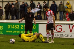 February 13 2016 - Kingfield Stadium - Woking - England - Guiseley's James Hurst (36) suffers cramp towards the end of the National League match between Woking & Guiseley.